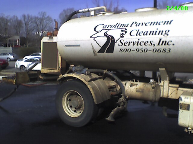 Water tanker belonging to Carolina Pavement Cleaning Services Inc. spewing water.